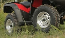 Radial tires provide a smooth ride and exceptional handling. Tough, large-diameter 25 x 8 - 12 front tires and 25 x 10 - 12 rear tires provide added ground clearance. Attractive large-diameter 12-inch aluminum wheels further reduce unsprung weight and contribute to superb handling.
