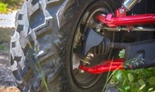 Dual front hydraulic disc brakes with large 190 mm rotors provide strong stopping power. The brake calipers feature a built-in scraper system that removes mud and snow from inside the front wheel to help prevent build-up of debris between caliper and rim for consistent braking performance. Inboard rear disc brake is mounted on the rear driveshaft, reducing unsprung weight and keeping the disc out of harm's way in rugged conditions.
