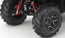 The Rubicon DCT Deluxe starts with all the same great features as the DCT IRS EPS, then adds lightweight aluminum wheels, red-painted shock springs, red-painted suspension arms and a unique white colour scheme.