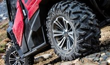 The Pioneer 1000-5 DLX comes standard with large 27-inch radial tires on special 12-inch aluminum wheels for excellent ride comfort, improved ground clearance and superior traction.